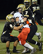 Truman's Antonio Fields #8 and Jackson Sutton #7 tackle Tennent's Ray Galdi #24 in the first quarter Friday October 30, 2015 at Harry S. Truman High School in Levittown, Pennsylvania.  (Photo by William Thomas Cain)