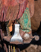 The boots, spurs, and chaps are functional pieces of equipment used every day by the American cowboy. As well as being functional they can be quite decorative and the spurs are often inlayed with silver or gold. This cowboy's chaps are short and fringed and called chinks.