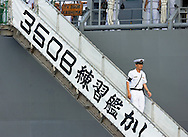 KEVIN BARTRAM/The Daily News.A crew member walks down the gangway of one of three Japan Training Squadron ships moored at Pier 26 in Galveston on Monday, July 10, 2006. The squadron's three ships will be in Galveston through Thursday as part of a 12 city visit to North America. The lead ship will be open for tours on Tuesday from 9:30-11:30 a.m. and 1:30-3:30 p.m. at Pier 26.