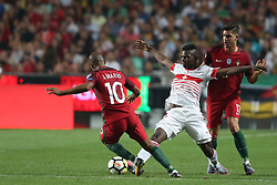 October 10, 2017 - Lisbon, Portugal - Portugal's midfielder Joao Mario (L) vies with Switzerland's forward Breel Embolo (C ) during the 2018 FIFA World Cup qualifying football match between Portugal and Switzerland at the Luz stadium in Lisbon, Portugal on October 10, 2017. Photo: Pedro Fiuza  (Credit Image: © Pedro Fiuza/NurPhoto via ZUMA Press)