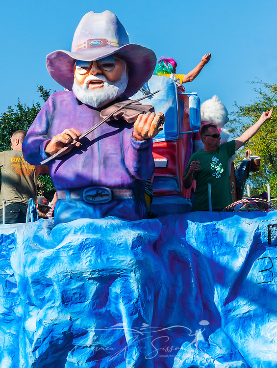 A parade float featuring Charlie Daniels travels down Washington Street in downtown Mobile, Ala., during the Joe Cain Procession at Mardi Gras, March 2, 2014. French settlers held the first Mardi Gras in 1703, making Mobile's celebration the oldest Mardi Gras in the United States. (Photo by Carmen K. Sisson/Cloudybright)
