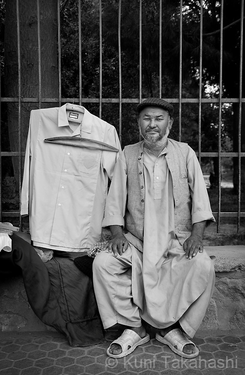 Sultan Ali, 46, Kabul (originally from Wardak), Street cloth vendor.in Kabul, Afghanistan on Aug 25, 2011.(Photo by Kuni Takahashi)