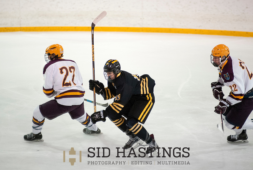6 FEB. 2017 -- BALLWIN, Mo. --  St. John Vianney High School hockey player Reid Zimmermann (19) competes with De Smet Jesuit High School's Owen Benben (27) and Justin Reynolds (22) during the game between the schools at the Greensfelder Recreation Complex in Edgar M. Queeny County Park in Ballwin, Mo. Monday, Feb. 6, 2017. Vianney topped De Smet 2-1. Photo © copyright 2017 Sid Hastings.