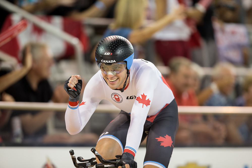 Remi Pelletier of Canada celebrates his team's bronze medal win in the men's cycling team pursuit at the 2015 Pan American Games in Toronto, Canada, July 19,  2015.  AFP PHOTO/GEOFF ROBINS