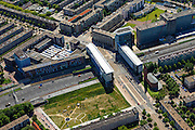 Nederland, Noord-Holland, Amsterdam, 14-06-2012; Slotervaart, Kolenkitbuurt met kerk De Kolenkit (Opstandingskerk). Ring A10 en Poortgebouw, rechts GAK-gebouw. Markt op het Bos en Lommerplein..De wijk is onderdeel van de Westelijke Tuinsteden, gerealiseerd op basis van het Algemeen Uitbreidingsplan voor Amsterdam (AUP, 1935). Voorbeeld van het Nieuwe Bouwen, open bebouwing in stroken, langwerpige bouwblokken afgewisseld met groenstroken. ..Residential district Slotervaart, one of the western garden cities of Amsterdam-west. Constructed on the basis of the General Extension Plan for Amsterdam (AUP, 1935). Example of the New Building (het Nieuwe Bouwen), detached in strips, oblong housing blocks alternated with green areas, built in fifties and sixties of the 20th century. The church is nicknamed Kolenkit (coal-hod) and so this district is called the Coal-hod district. A10 Ringroad crosses the neighbourhood.  .luchtfoto (toeslag), aerial photo (additional fee required).foto/photo Siebe Swart