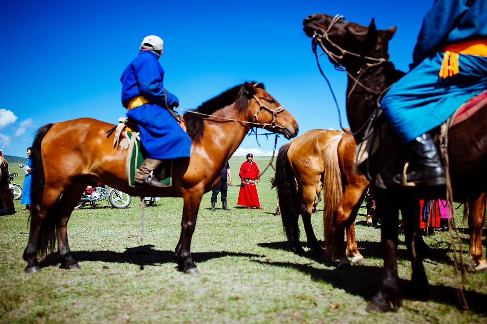 Groups of Mongolian men and their horses during the traditional Naadam festival in Tsagaannuur, northern Mongolia.