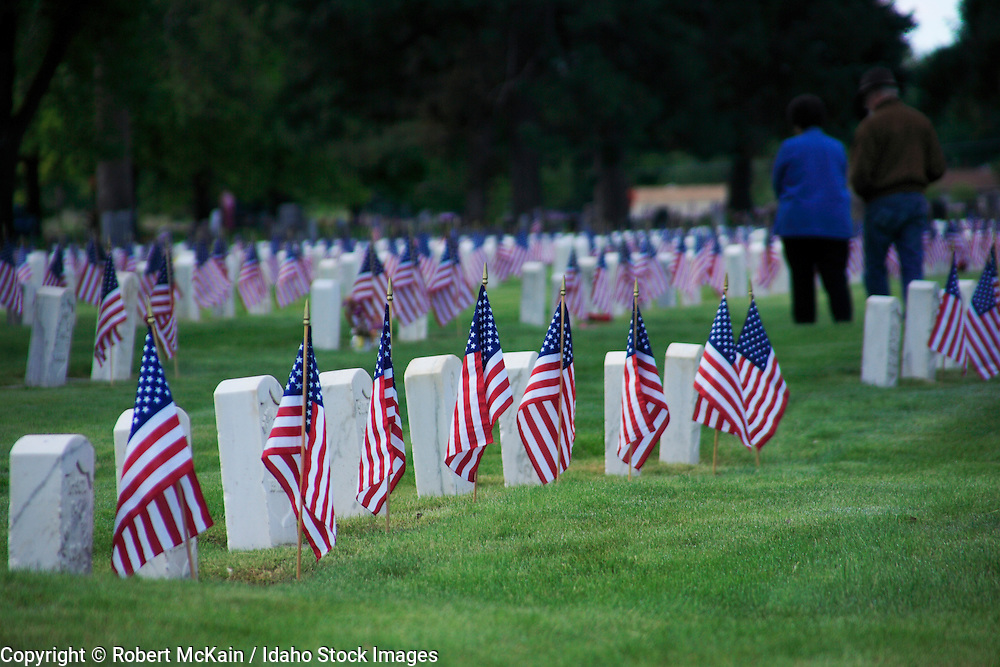 IDAHO. Boise. Morris Hill Cemetery, Silent Camp. Flags on military gravestones on Memorial Day. May 2006 #hm060107