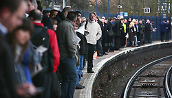 File photo dated 05/03/09 of commuters waiting on a platform. Fewer than one in seven people walk to work, with most losing up to 16 days a year on commuting, a study has found.