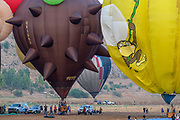 ground crew is preparing hot air balloons for launch