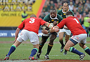 The Beast, The Beast, Tendai Mtawarira of the Springboks is tackled by Phil Vickery and Andrew Sheridan of the Lions.<br /> Rugby - 090704 - Springboks vs British&Irish Lions - Coca-Cola Park - Johannesburg - South Africa. The Lions won 28-9 but lost the series 2-1 to the Springboks.<br /> Photographer : Anton de Villiers / SASPA
