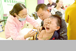 April 25, 2018 - Shijiazhuang, China - A young boy cries while he receives vaccination at a disease control center in Shijiazhuang, north China's Hebei Province. (Credit Image: © SIPA Asia via ZUMA Wire)