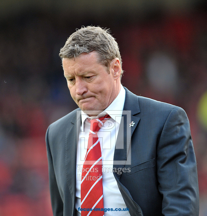 Danny Wilson manager of Barnsley shows his disappointment after their loss to Leeds United during the Sky Bet Championship match at Oakwell, Barnsley<br /> Picture by Graham Crowther/Focus Images Ltd +44 7763 140036<br /> 19/04/2014