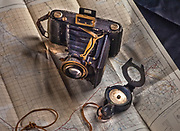 Old style Zeiss Nettar bellows film camera with compass and surveyor's plan