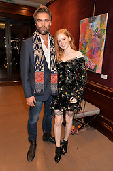 ELLIE BAMBER and JASPER SKINNER at the opening of the exhibition 'My Mother Was A Reeler' at Etro, 43 Old Bond Street, London on 5th October 2016.
