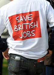 "© licensed to London News Pictures. LONDON, UK.  07/09/11. A man wear a t-shirt that says ""Save British Jobs'.  A large group of Unite members working at Bombardier, along with business leaders and Derby councillors call on the government to ""save British train manufacturing"" outside parliament today. The delegation's visit, which coincides with the Transport Committee hearing, includes Unite general secretary Len McCluskey, the leader of Derby City Council and the Mayor of Derby.. Mandatory Credit Stephen Simpson/LNP"