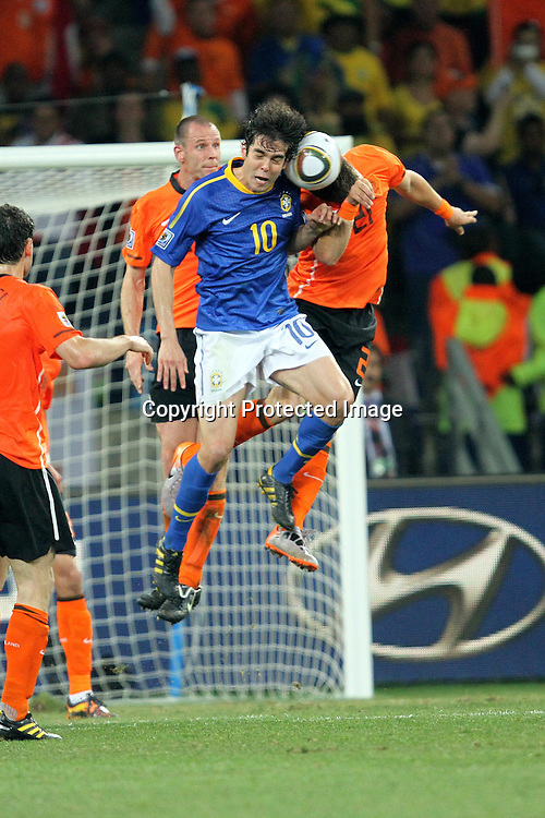 Kaka of Brazil and Klaas Jan Huntelaar of Netherlands battle for the ball during the FIFA World Cup 2010 quarter final match between The Netherlands and Brazil held at The Nelson mandela Bay in Port Elizabeth, South Africa on the 2nd July 2010<br /> <br /> <br /> Photo by Ron Gaunt/SPORTZPICS