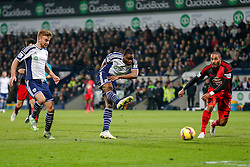 Brown Ideye of West Brom scores a goal to make it 1-0 as Ashley Williams of Swansea City challenges - Photo mandatory by-line: Rogan Thomson/JMP - 07966 386802 - 11/02/2015 - SPORT - FOOTBALL - West Bromwich, England - The Hawthorns - West Bromwich Albion v Swansea City - Barclays Premier League.