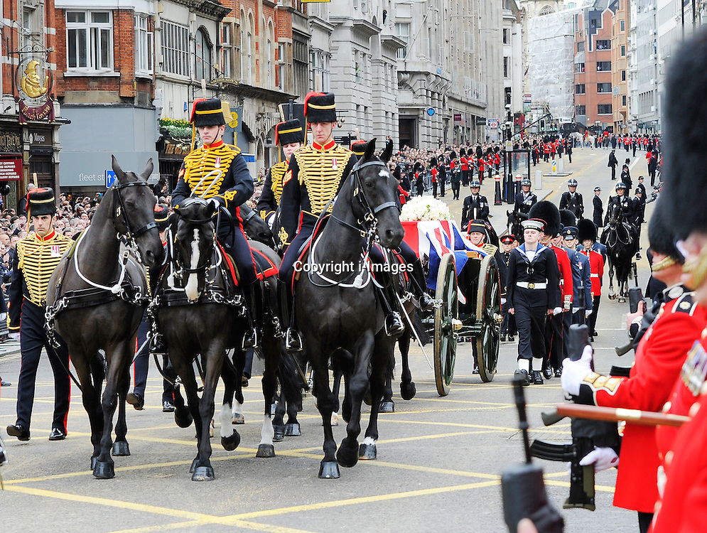 Baroness Thatcher's coffin is carried on the gun barrel towards St Paul's Cathedral, Ludgate Circus, London, UK, Wednesday 17 April, 2013, Photo by: i-Images