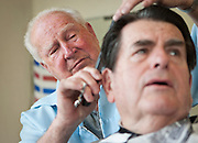 Barber Clyde Ashcroft, left, gives longtime customer Jerry Clayton a trim at Clyde's barbershop at 3609 S. State, Friday, Dec. 28, 2012. Today is Ashcroft's final day working as a barber after 58 years of cutting hair in Salt Lake City.