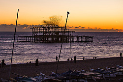 © Licensed to London News Pictures. 12/11/2017. Brighton, UK. thousands of Starlings murmuring at sunset over the Brighton and Hove West Pier. Photo credit: Hugo Michiels/LNP