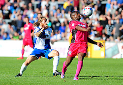Bristol Rovers' Stuart Sinclair challenges Dover Athletic's Solomon Taiwo - Photo mandatory by-line: Neil Brookman - Mobile: 07966 386802 - 04/10/2014 - SPORT - Football - Bristol - Memorial Stadium - Bristol Rovers v Dover - Vanarama Football Conference