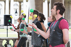 © Licensed to London News Pictures. 19/05/2015. London, UK. Gandini Juggling performing. Launch of The Royal Greenwich Festivals 2015 at the Old Royal Naval College, Greenwich.  Photo credit : Bettina Strenske/LNP