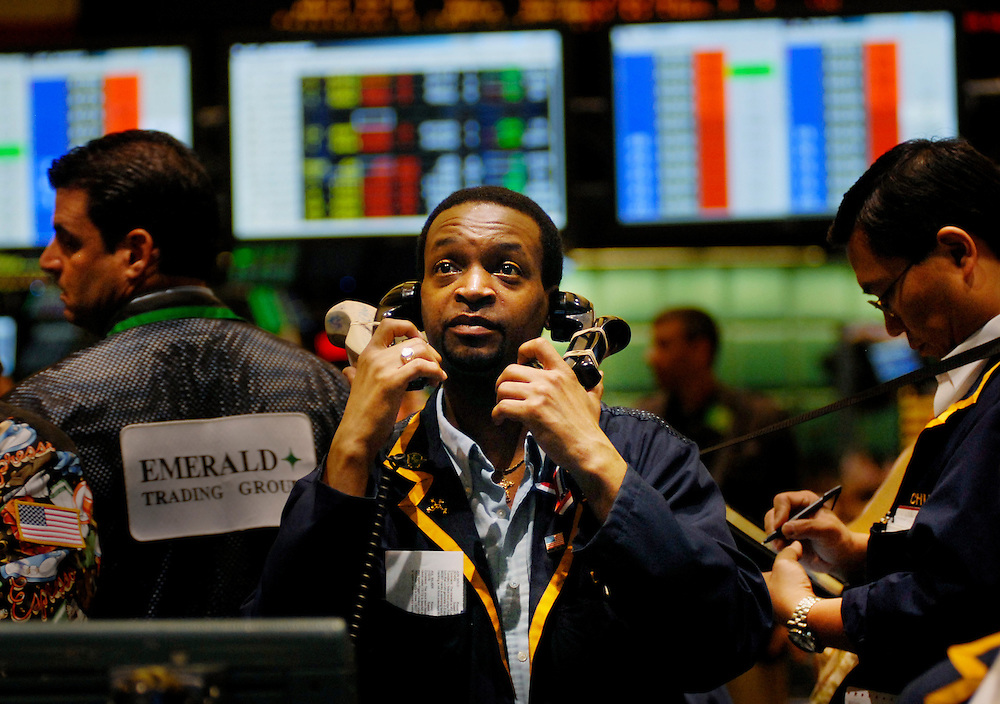 A trader handles multiple phones whilst dealing in metals and petroleum futures and options on the trading floor on the New York Mercantile Exchange (NYMEX) , New York City..The New York Mercantile Exchange, Inc., is the world's largest physical commodity futures exchange and the preeminent trading forum for energy and precious metals..