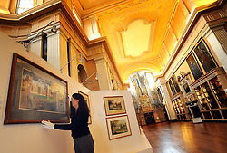 © Licensed to London News Pictures. 09/02/2012, Woodstock, UK. Staff prepare the exhibition for viewing. Blenheim Palace hosts its very first art exhibition in the Long Library - a previously unseen display of work by the renowned 20th century British artist, John Piper (1903-1992). The paintings focus on Piper's depictions of The Palace and the surrounding Oxfordshire environment. At 55 metres, The Long Library is one of the longest rooms in any British stately home and was designed by Vanbrugh as a picture gallery. The Willis Organ takes pride of place at the north end of the room surrounded by over 10,000 books. The exhibition is open to public 11th February - 9th April 2012.  Photo credit : Stephen Simpson/LNP