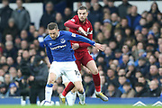 Everton midfielder Gylfi Sigurosson (10) and Liverpool midfielder Jordan Henderson (14) during the Premier League match between Everton and Liverpool at Goodison Park, Liverpool, England on 3 March 2019.