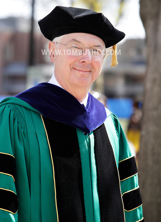 New SUNY New Paltz president Donald P. Christian smiles while walking in the processional to Julien J. Studley Theatre during his installation ceremony on Friday, April 13, 2012.
