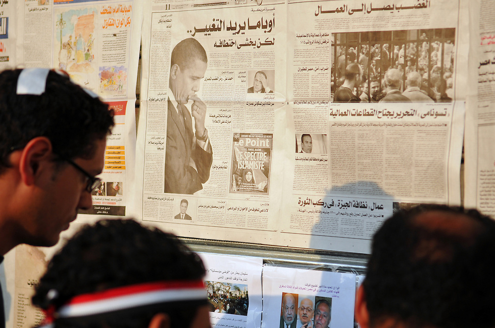 "During the ""January 25"" revolution, Egyptians in Tahrir Square read the day's newspapers posted on a wall. American policy impacts the lives of people in the Arab world, and the U.S. President can be found daily in local media. (Cairo, Egypt - February 9, 2011)"
