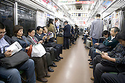 business people during there evening commute towards home Japan Tokyo
