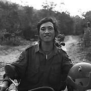 A scrap metal collector at La Hap, along the Ho Chi Minh Trail, Laos, about 50km west of Hamburger Hill. Collectors often spend weeks or even month on end in the thick jungle, dragging large pieces of Vietnam War-era scrap metal to the roadside, awaiting pickup by transport trucks every few months.