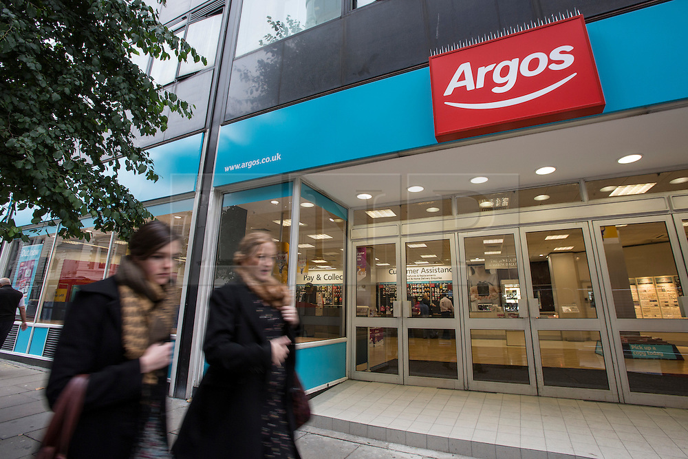 © licensed to London News Pictures. London, UK 24/10/2012. People walking past an Argos store in London on 24/10/12. Argos announced that it will cut circulation of traditional catalogue and lead to at least 75 store closures or relocations. Photo credit: Tolga Akmen/LNP
