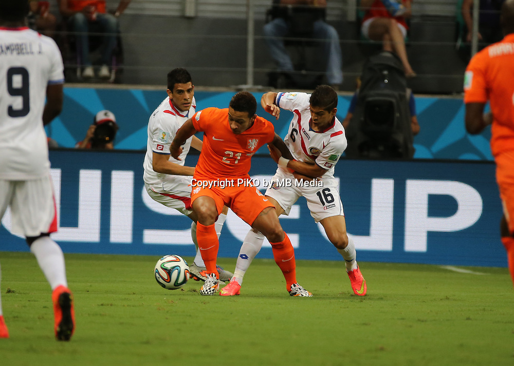 Fifa Soccer World Cup - Brazil 2014 - <br /> NETHERLANDS (NED) Vs. COSTA RICA (CRC) - Quarter-finals -Arena Fonte Nova Salvador (BRA)- Brazil (BRA) - 05 July 2014 <br /> Here Holland player Memphis DEPAY (C). Costa Rican players Johnny ACOSTA (L) and Cristian GAMBOA (R)<br /> &copy; PikoPress