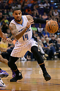 Mar 17, 2017; Phoenix, AZ, USA; Orlando Magic guard D.J. Augustin (14) handles the ball against the Phoenix Suns in the first half of the NBA game at Talking Stick Resort Arena. Mandatory Credit: Jennifer Stewart-USA TODAY Sports