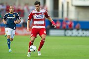 FRISCO, TX - AUGUST 11:  George John #14 of FC Dallas controls the ball against the Los Angeles Galaxy on August 11, 2013 at FC Dallas Stadium in Frisco, Texas.  (Photo by Cooper Neill/Getty Images) *** Local Caption *** George John