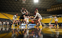 March 10, 2020, Long Beach, California, USA: Cal Poly Mustangs forward ALICIA ROUFOSSE, left, grabs a rebound from Long Beach State forward CYDNEE KINSLOW, right, in an empty Walter Pyramid in the Big West tournament in Long Beach on Tuesday. Fears over the coronavirus have forced tournament organizers to ban fans from the games this week. (Credit Image: © Scott Varley/Orange County Register via ZUMA Wire)