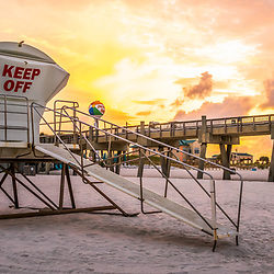 Pensacola Beach lifeguard tower five and Gulf Pier sunrise panorama photo on Casino Beach. Pensacola Beach Florida is a coastal city on Santa Rosa Island in the Emerald Coast of the Southeastern United States of America. Panoramic photo ratio is 1:3. Copyright ⓒ 2018 Paul Velgos with All Rights Reserved.