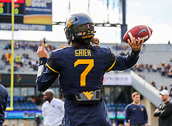 Oct 28, 2017; Morgantown, WV, USA; West Virginia Mountaineers quarterback Will Grier (7) warms up before their game against the Oklahoma State Cowboys at Milan Puskar Stadium. Mandatory Credit: Ben Queen-USA TODAY Sports