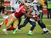 Nov 26, 2017; Santa Clara, CA, USA; Seattle Seahawks quarterback Russell Wilson (3) appears to be sacked by San Francisco 49ers defensive tackle DeForest Buckner (99) but escapes at Levi's Stadium.  Seattle beat San Francisco 24-13.
