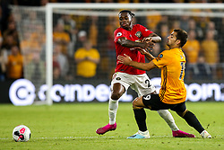 Aaron Wan-Bissaka of Manchester United takes on Jonny of Wolverhampton Wanderers - Mandatory by-line: Robbie Stephenson/JMP - 19/08/2019 - FOOTBALL - Molineux - Wolverhampton, England - Wolverhampton Wanderers v Manchester United - Premier League
