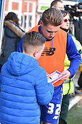 Bury Forward, Danny Rose signs a young fans programe before during the The FA Cup fourth round match between Bury and Hull City at Gigg Lane, Bury, England on 30 January 2016. Photo by Mark Pollitt.