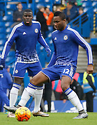 Chelsea midfielder John Mikel Obi warming up before the Barclays Premier League match between Chelsea and Everton at Stamford Bridge, London, England on 16 January 2016. Photo by Andy Walter.