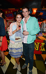 GRACE YOUNG and JAMIE DUNDAS at a party to celebrate the launch of Charlie Gilkes and Duncan Stirling's new nightclub 'Disco' at 13 Kingly Court, London on 26th June 2013.