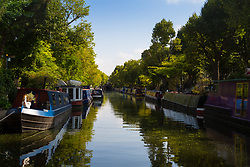 According to the Met Office, August 31st marks the last day of summer and there certainly is a bit of a nip in the air around Little Venice in London as morning sunshine lights up narrowboats moored along the Regents and Grand Union canals. London, August 31 2018.