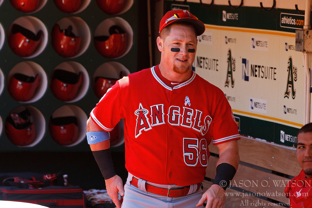 OAKLAND, CA - JUNE 21:  Kole Calhoun #56 of the Los Angeles Angels of Anaheim stands in the dugout before the game against the Oakland Athletics at O.co Coliseum on June 21, 2015 in Oakland, California. The Oakland Athletics defeated the Los Angeles Angels of Anaheim 3-2. (Photo by Jason O. Watson/Getty Images) *** Local Caption *** Kole Calhoun