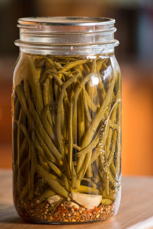 Jar of pickled green beans, also known as dilly beans.