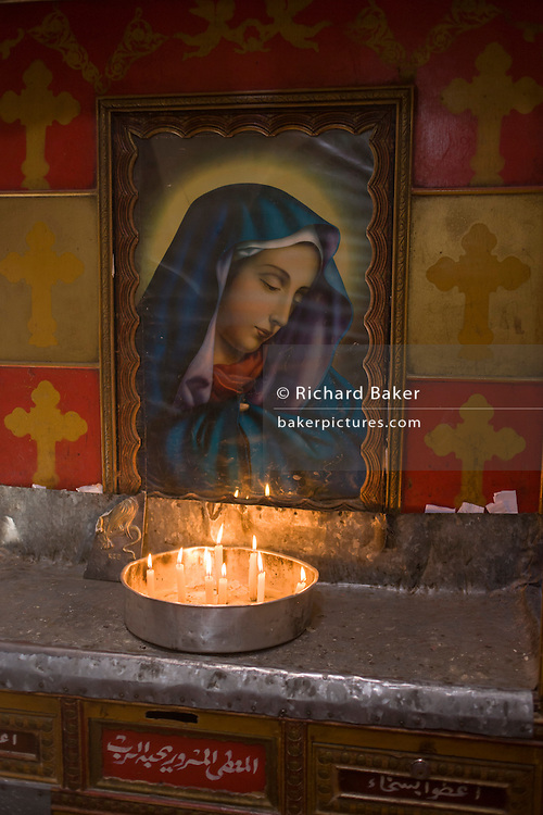 The Virgin Mary's icon shrine with burning candles at St Tawdros (St Theodore's) Coptic Orthodox Christian Monastery, Luxor, Nile Valley, Egypt. The Copts are an ethno-religious group in North Africa and the Middle East, mainly in the area of modern Egypt, where they are the largest Christian denomination. Christianity was the religion of the vast majority of Egyptians from 400–800 A.D. and the majority after the Muslim conquest until the mid-10th century. Today, there are an extimated 9-15m Copts in Egypt.