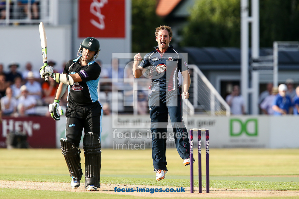Steven Crook of Northants Steelbacks (right) celebrates after taking the wicket of Daryl Mitchell of Worcestershire Rapids (left) during the Natwest T20 Blast match at the County Ground, Northampton<br /> Picture by Andy Kearns/Focus Images Ltd 0781 864 4264<br /> 18/07/2014